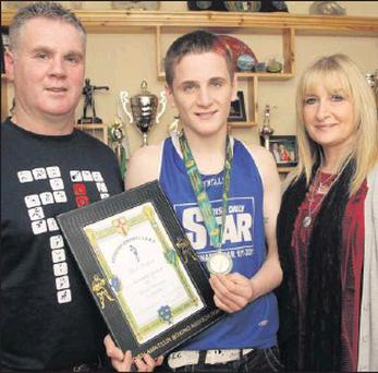 Leinster boxing champion Dean Walsh with his proud parents, Donal and Kathleen.
