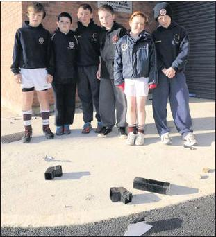 St. Finian's players Jack Malone, Ciaran Doyle, Adam McGuirk, Andrew Crowley, Rachel McGuirk and Kieran Murnane survey some of the damage at the Ridgewood changing rooms.
