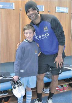 Ethan McGarry with Manchester City defender Joleon Lescott.