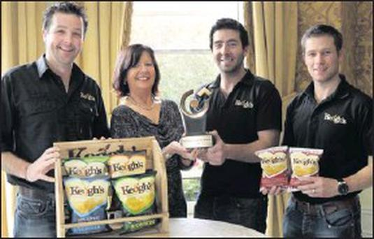 Tom, Ross and Derek Keogh of Keogh's Crisps with Rita Guinan from the County and City Enterprise Boards.