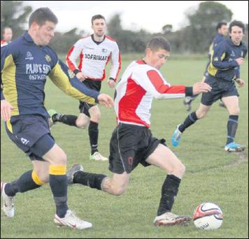 Darren Naughton (Kilmore United) and Aaron Kehoe (Rosslare Rangers) in action during Sunday's south county Division 1 derby in Ballyseskin which the visitors won 2-1.