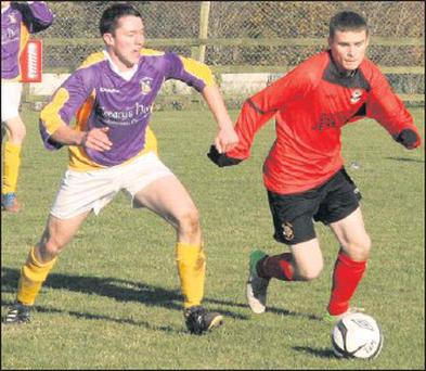 Graham Staples of Wexford keeps tabs on his Carlow opponent during Saturday's clash.