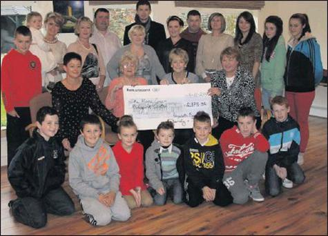 Members of the Byrne family present a cheque for almost €3,000 to Ann Marsh and Margo Kehoe of the HOPE Centre.