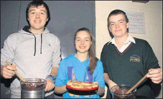 Declan Wildes, Aine Collier and Gary Rice at the Gorey Community School cake sale.