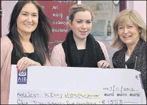 Elaine Higgins and Melanie Brosnan of Pure Beauty Salon, Dingle, presenting Ursula O'Connell of Kerry Hospice Foundation with a cheque for €1,558. Credit: Photo by Marian O'flaherty