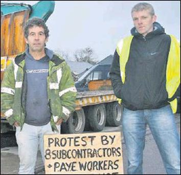 West Kerry subcontractors Sean Moriarty and Liam Ó Baicéir protesting at Annascaul on the N86 early last week. Credit: Photo by Marian O'flaherty