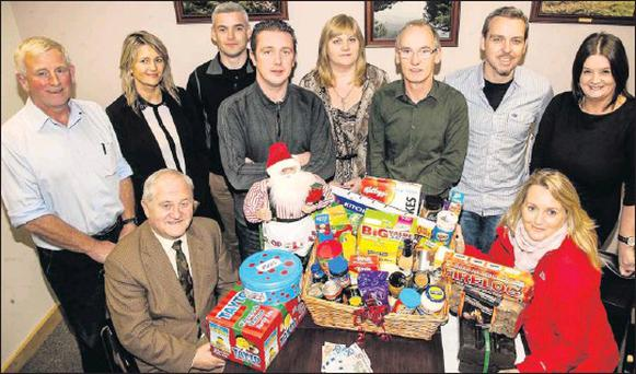 Christy Leahy and Clare Tobin of St Vincent de Paul, Tralee (seated left and right), with staff from The Kerryman launching the charity's Christmas Appeal at The Kerryman offices in Denny Street, Tralee, on Monday. Back, from left; Tommy King,...