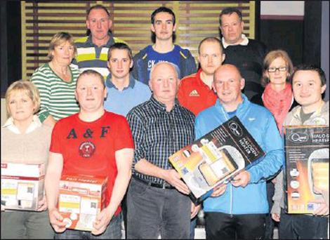 At the presentation of prizes of the Gleneagle Squash Club monthly competition sponsored by O'Keeffe Oils were front from left, Helen O'Donoghue, Arthur Murphy, John D O'Keeffe, sponsor, Michael McAuliffe, winning captain and Mike O'Donoghue. In second...