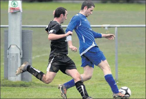 Tralee Dynamos, Jamie McIntyre and Ennis Town Rock's Ethan Considine in a struggle for control during their Munster Junior Cup Game at Mounthawk Park on Sunday afternoon. Photo: John Reidy