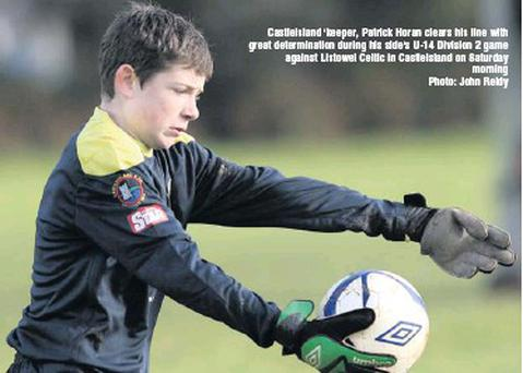 Castleisland 'keeper, Patrick Horan clears his line with great determination during his side's U-14 Division 2 game against Listowel Celtic in Castleisland on Saturday morning Photo: John Reidy