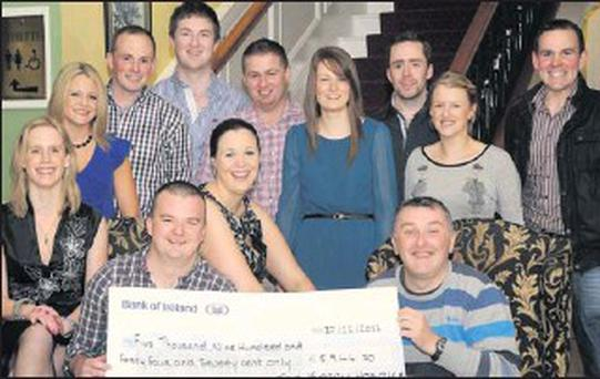 Kevin McGuire, of the Kerry Fours Peaks Challenge, presenting the proceeds of the Challange €5,944.70 to Conor Cusack and Margaret Gaynor, Kerry Hospice, with Aoife O'Sullivan, Emer Gallagher, Paddy Crowley, Donal O'Mahony, Paudie Keohane, Aisling... Credit: Photo by Michelle Cooper Galvin