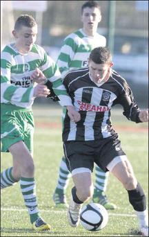 Newcastlewest FC's Mateusz Pavulski gets to the ball before Killarney Celtic's Matthew Keane in the Umbro FAI U17 challenge Cup.