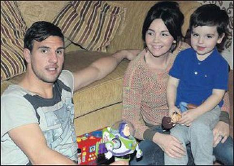 Gavin and Debi Peers relax at home with their son Bradley.