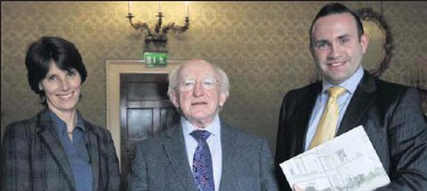 Sarah Slavenger from Powerscourt Estate with President Higgins and author David Hicks.