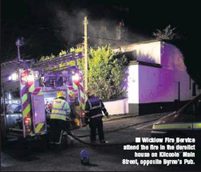 Wicklow Fire Service attend the fire in the derelict house on Kilcoole Main Street, opposite Byrne's Pub.