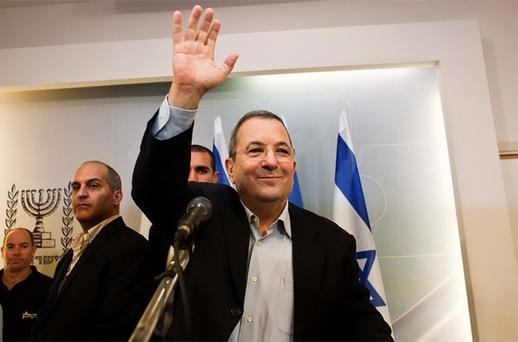 Israel's Defence Minister Barak waves after a news conference in Tel Aviv. Photo: Reuters