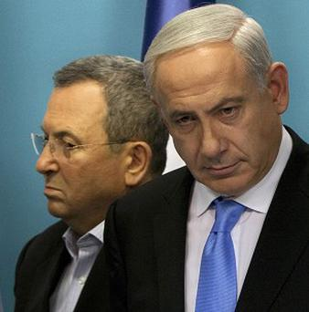 Israeli Defence Minister Ehud Barak, left, has reportedly fallen out with Prime Minister Benjamin Netanyahu (AP)