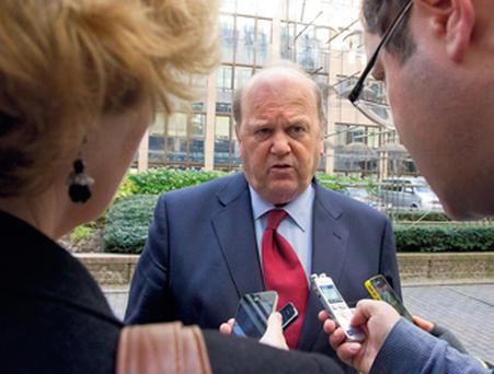 Finance Minister Michael Noonan talks to the press as he arrived for the Eurogroup meeting of eurozone finance ministers in Brussels yesterday.