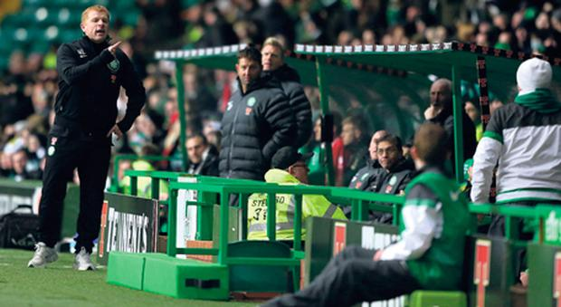 Celtic manager Neil Lennon argues with a Celtic fan seated near the dug-out during the defeat by Inverness.