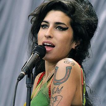 The portrait of Amy Winehouse shows her trademark eyeliner