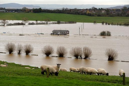 A property surrounded by floodwater next to the River Severn in Tewkesbury, Gloucestershire. Photo: PA