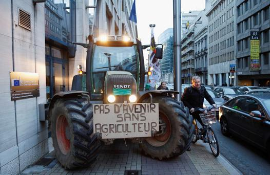A tractor blocks the entrance of the European Commission's agriculture office during a protest by European milk producers in central Brussels November 27, 2012. REUTERS/Francois Lenoir