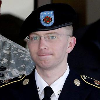 Bradley Manning is escorted out of a courthouse in Fort Meade (AP)