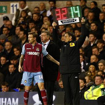 Mark Clattenburg, right, returned to duties as a fourth official last weekend