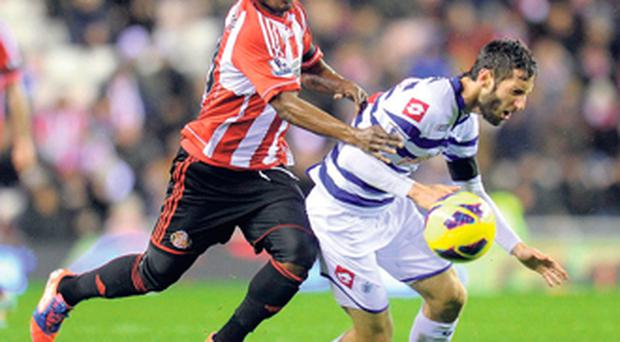 Sunderland's Stephane Sessegnon (left) in action against QPR's Esteban Granero at the Stadium of Light