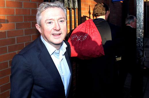 X Factor judge Louis Walsh on his way into court for his defamation case against Rupert Murdoch's News Group Newspapers. Photo: PA