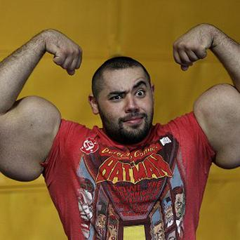 Egyptian body builder Moustafa Ismail poses during his daily workout at World Gym in Milford, Massachusetts (AP)