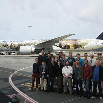 Some of the Hobbit cast and crew with the specially-painted airliner (AP)