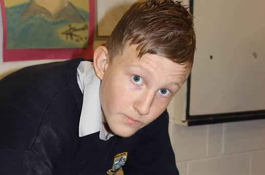 Second Year Deele College student Michael Devine during an anti-bullying art project at the school. Pupils printed their hands on a giant mural