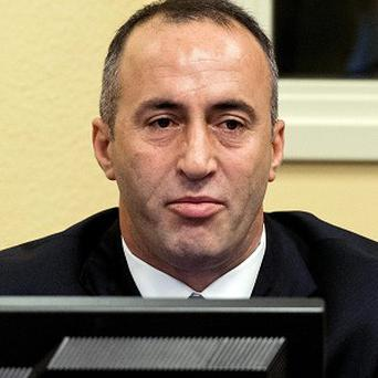 Former Kosovo PM Ramush Haradinaj awaits the verdict in a courtroom in The Hague, Netherlands (AP Photo/ Koen van Weel)