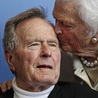 Ex-president George H W Bush, and his wife Barbara (AP)
