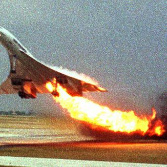 The Air France Concorde takes off with fire trailing from its engine before crashing into a hotel (AP)