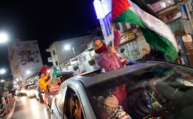 Palestinians celebrate on the streets of Ramallah in the West Bank after the UN vote. Photo: Getty Images