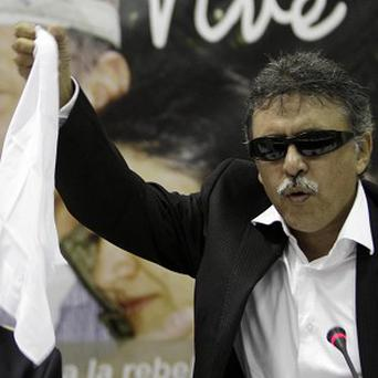 Jesus Santrich from the Revolutionary Armed Forces of Colombia, or FARC, waves a white handkerchief (AP)