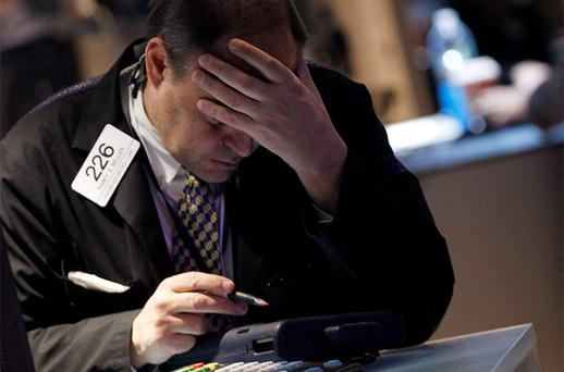 A trader works on the floor of the New York Stock Exchange. Photo: Reuters