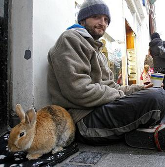 John Byrne, who has been homeless and on the streets of Dublin for 25 years with, his pet rabbit Barney and dog Roxy