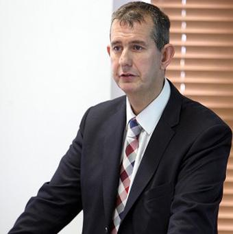 Edwin Poots told the Assembly he did not believe the fire was linked to the fabric of the hospital building