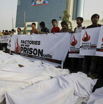 There have been a series of protests after a fire killed 112 people at the Tazreen Fashions factory (AP)