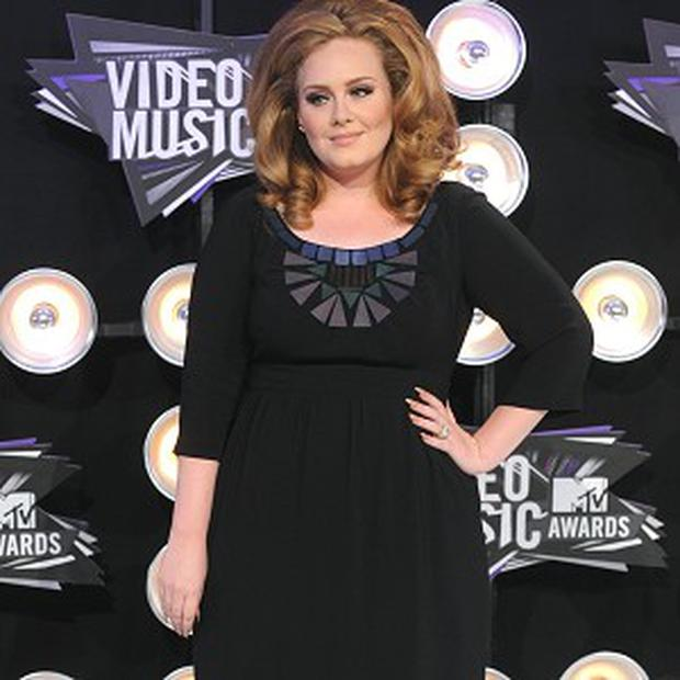 New mum Adele would be back making music if Louis Walsh was her manager