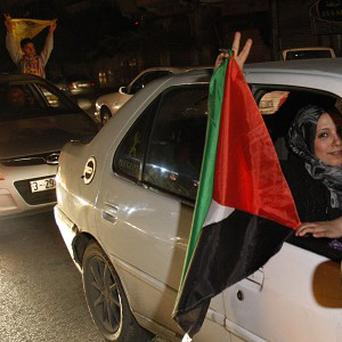 Palestinians celebrate after the UN General Assembly backed an independent state of Palestine (AP)