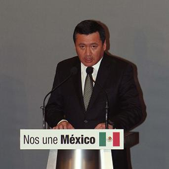 Transition team leader Miguel Angel Osorio Chong speaks during the presentation of the cabinet (AP)