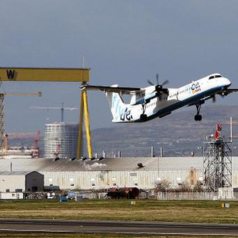 Air passenger duty should be scrapped on all flights to and from Northern Ireland, a group of MPs has said
