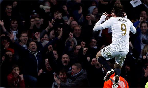 Miguel Michu celebrates after scoring against Arsenal