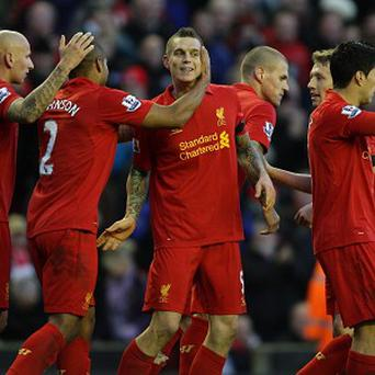 Daniel Agger's, centre, effort was enough for three points against Southampton