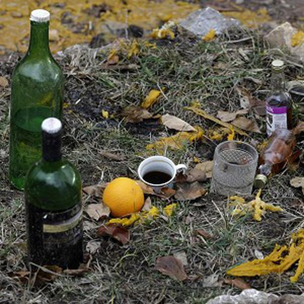 Drinks are left on the grave of a deceased man, in the village of Zarozje, near the Serbian town of Bajina Basta (AP)