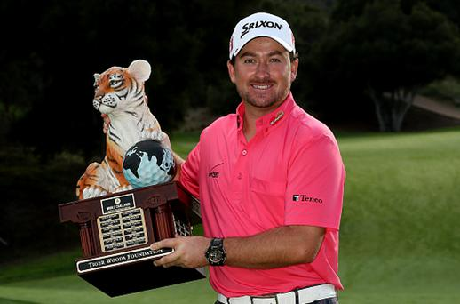 Graeme McDowell of Northern Ireland poses with the trophy after his three stroke victory in the final round of the Tiger Woods World Challenge. Photo: Getty Images